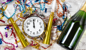 new year's resolutions for back pain with clock and champagne