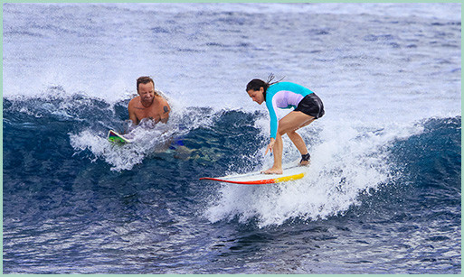 Former patient, Becky, surfs in Hawaii after undergoing spinal fusion surgery.