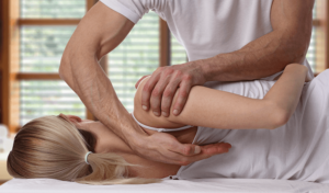woman with spinal stenosis receives chiropractic care