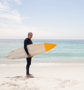 Man surfing after redefining relief with minimally invasive microdisectomy