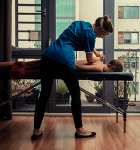 woman receiving massage therapy for back pain